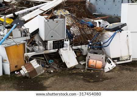 Pile of scrap white goods including fridges and freezers awaiting to be recycled - stock photo