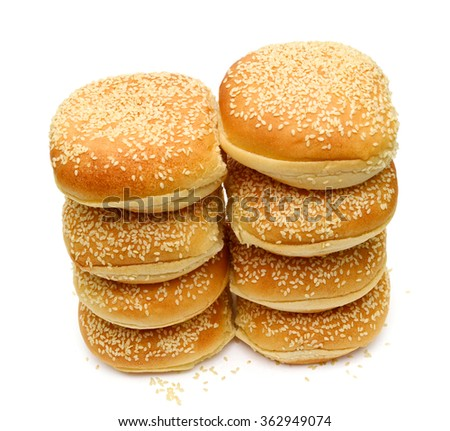 pile of sesame buns isolate on white