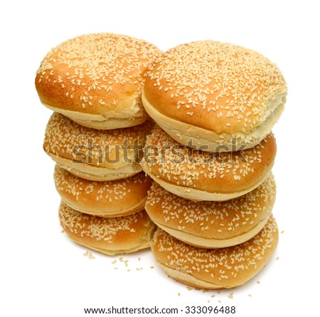 pile of sesame buns isolated on white