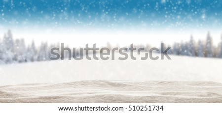 Pile of snow with blur winter panorama. Landscape with spruce trees, blue sky with sun light on background. Panoramatic view