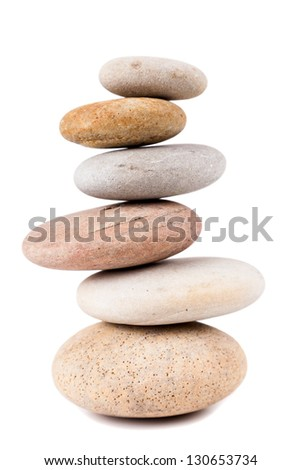Pile of spa stones isolated on white background - stock photo