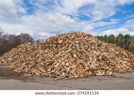 Pile of split fire wood prepared for winter - stock photo