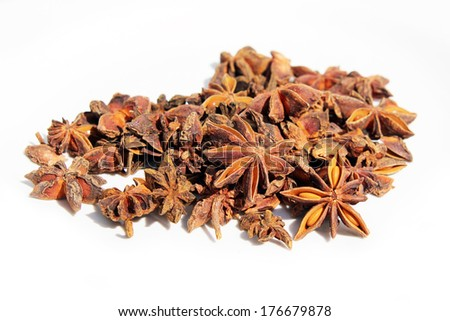 Pile of star anise on white background