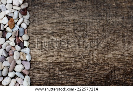 pile of stones on the side with the old cracked wooden background - stock photo