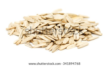 pile of sunflower seeds on a white background