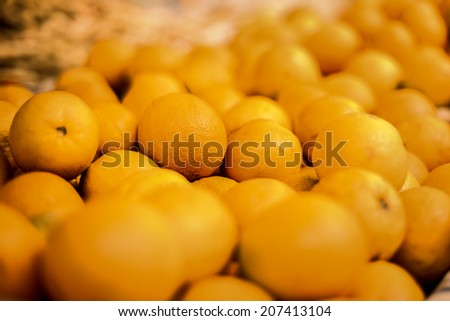 Pile of tasty orange Tangerine fruits at a local farmer's market in Funchal, Madeira. - stock photo