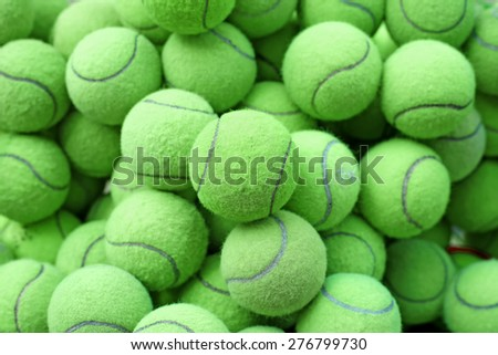 pile of tennis ball as sport background - stock photo