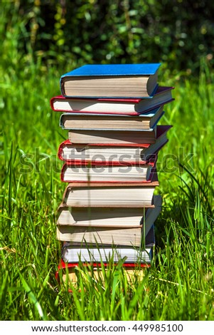 Pile of the Books on the Grass - stock photo