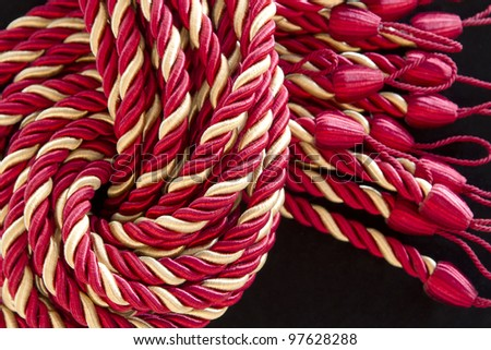 pile of the silk rope curtain tassels. - stock photo