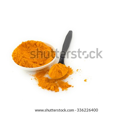 Pile of the turmeric powder in white bowl and spoon isolated on white - stock photo