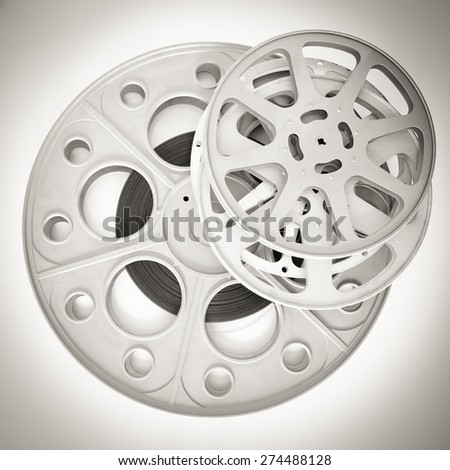 Pile of three different movie reels with 35mm film in black and white square frame - stock photo