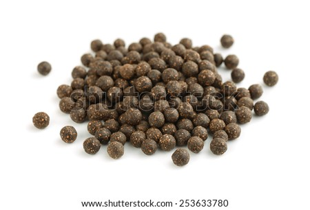 Pile of traditional chinese natural herbal pills isolated on white - stock photo