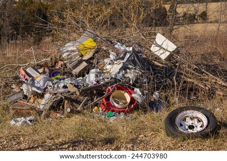 Pile of trash in a field - stock photo
