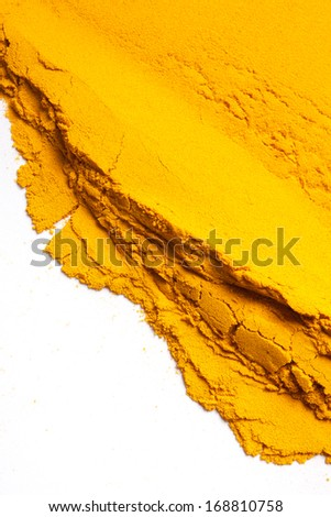 Pile of Turmeric powder isolated on a white background