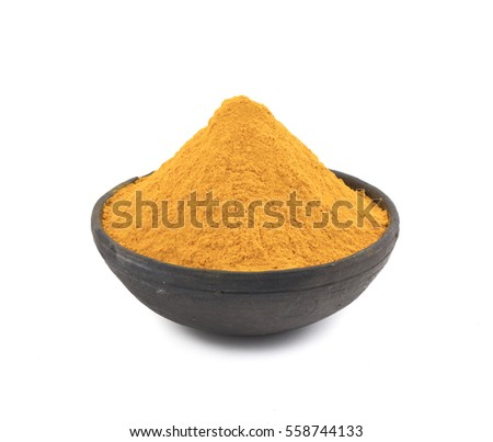 Pile of turmeric powder isolated on white background