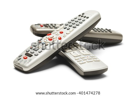 Pile of TV Remote Controls Isolated on White Background. - stock photo