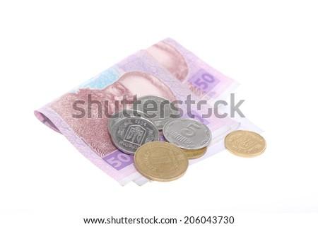 Pile of Ukrainian money, isolated on white - stock photo
