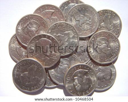 pile of united states Susan B. Anthony dollars - stock photo
