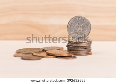Pile of US coins on wood background - stock photo