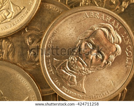 Pile of US Gold Presidential Dollar Featuring Abraham Lincoln - stock photo