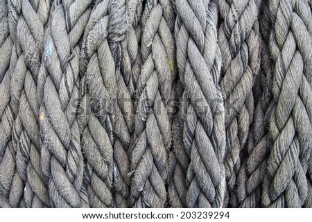 pile of used and old thick ship ropes - stock photo