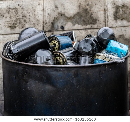 Pile of used oil filter of a car engine - stock photo