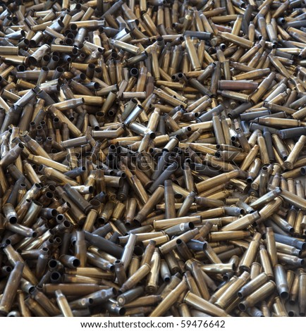 Pile of used pistol and rifle cartridges