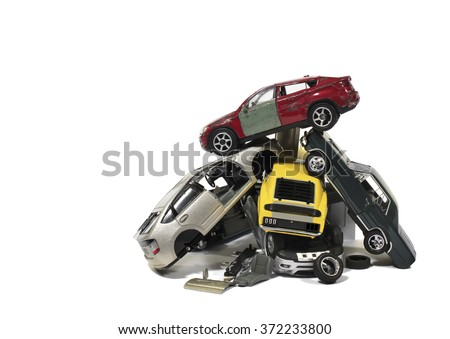 Pile of used wrecked cars in Junkyard (models) - stock photo