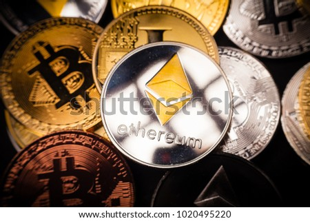 Pile of various Cryptocurrencies (Bitcoin, Ethereum, Litecoin)