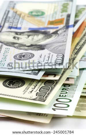 Pile of various currencies close-up. - stock photo