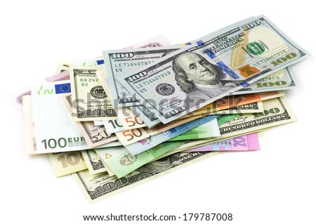 Pile of various currencies isolated on white background. - stock photo