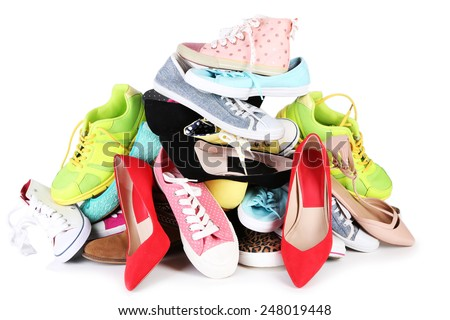 Pile of various female shoes isolated on white - stock photo