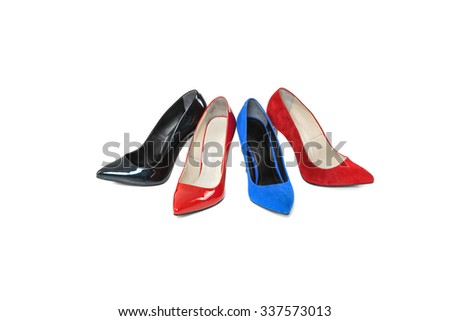 Pile of various female shoes over white background
