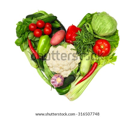 Pile of vegetables shaped as heart isolated on white background - stock photo