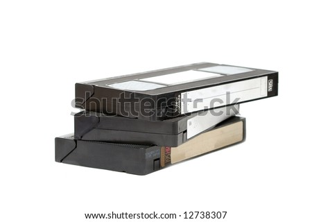 Pile of VHS video cassettes isolated on white - stock photo
