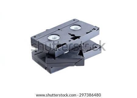 Pile of videotapes on  white background, studio shot - stock photo
