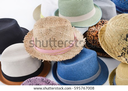 Pile of vintage hat with a ribbon on white background