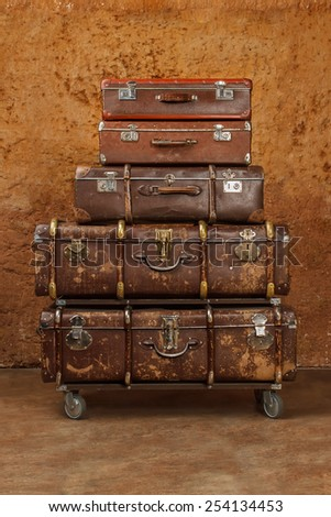 Pile of vintage suitcases. Vintage travel luggage