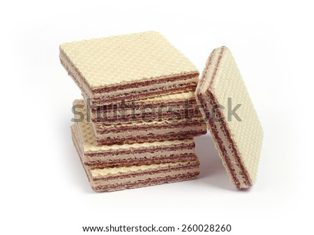 Pile of wafers with chocolate on white background - stock photo