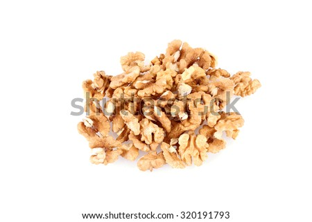 Pile of walnut kernels isolated on a white background