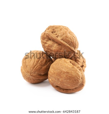 Pile of walnuts isolated over the white background