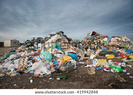 Pile of waste at city landfill. Waste management, ecology concept - stock photo