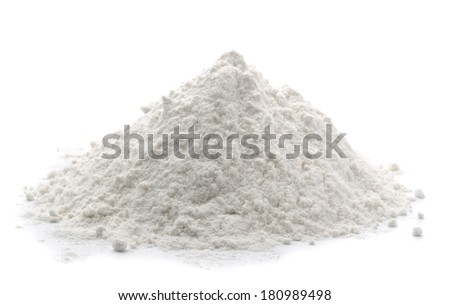 Pile of wheat flour isolated on white - stock photo
