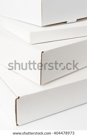 Pile of white cardboard boxes