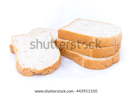 pile of whole grain bread slice isolated on white background.  breads is breakfast on every morning.  - stock photo