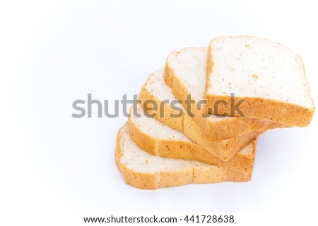 pile of whole grain bread slice isolated on white background.breakfast food on every morning - copy space - stock photo