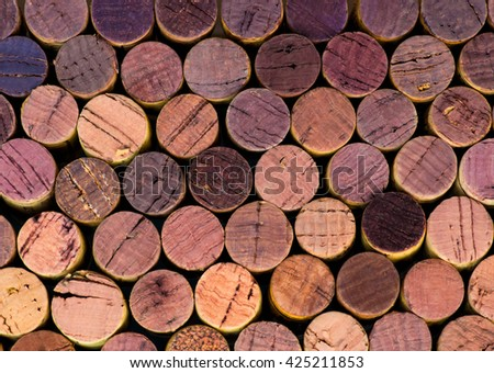 pile of wine corks with different shades of violet and red