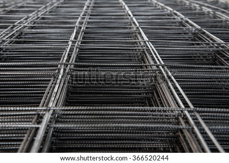 Pile of wire mesh. Reinforcement material of concrete pouring. Depth of field concept. Selection focus to texture of material. - stock photo