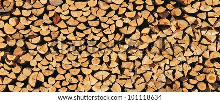 Pile of wood cut for fireplace - stock photo
