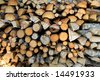 Pile of wood, cut in pieces for firewood - stock photo